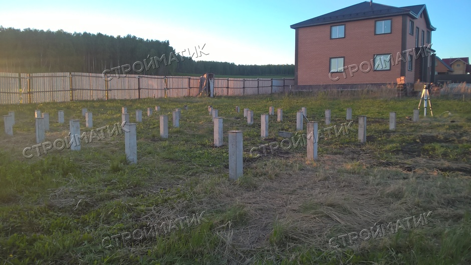 Фундамент на забивных ж/б сваях для двухэтажного дома из бруса с верандой в Шайдурово, Челябинск от компании Стройматик